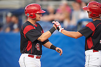 Batavia Muckdogs Corey Bird (right) congratulates Jarett Rindfleisch (44) after scoring a run during a game against the Staten Island Yankees on August 27, 2016 at Dwyer Stadium in Batavia, New York.  Staten Island defeated Batavia 13-10 in eleven innings. (Mike Janes/Four Seam Images)
