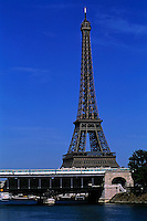 Métro train system travelling over the Seine with the Eiffel Tower in the background, Paris, France.