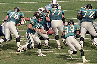 QB Mark Brunell, #8 hands off to RB James Stewart, #33, during the NFL AFC Championship game, which the Tennessee Titans won over the Jacksonville Jaguars 33-14 on January 23, 2000 in Jacksonville, FL.  (Photo by Brian Cleary/bcpix.com)