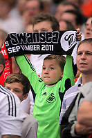 Pictured: A young Swansea supporter with scarf. Saturday 10 September 2011<br /> Re: Premiership Arsenal v Swansea City FC at the Emirates Stadium, London.