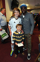 Pictured: Nathan Dyer (R) with two young supporters. Thursday 15 December 2011<br /> Re: Children  have who have been treated at the burns unit of Morriston Hospital have met Swansea City FC players at the Liberty Stadium.