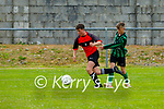 Tralee Dynamos Ryan O'Driscoll gets past Kealen Dowd of  Fenit Samphires during their encounter in the U14 cup competition.