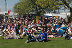 Badminton Horse Trials Gloucestershire UK. Some spectators watch the action on a large outdoor screen.