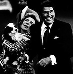 """40th President of the United States Ronald Wilson Reagan with wife Nancy hold their dog, Ronald Reagan was 33rd Governor of California began a career as an actor first in films then television appearing in 52 movie productions served as president of the Screen Actors Guild originally a member of the Democratic Party switched to the Republican Party in 1962, President Reagan implemented sweeping new political and economic initiatives supply-side economic policies dubbed """"Reaganomics"""" controlling the money supply to reduce inflation and spurring economic growth by reducing tax rates took a hard line against labor unions and ending of Cold War,"""