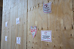 Signs advising people to call 911 if they see someone with a gun are displayed on a boarded up hotel ahead of President-Elect Joe Biden's Inauguration on January 19, 2021 in Washington, D.C..  Photograph by Michael Nagle