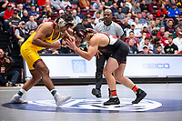 STANFORD, CA - March 7, 2020: Anthony Valencia of Arizona State University and Jared Hill of Stanford during the 2020 Pac-12 Wrestling Championships at Maples Pavilion.