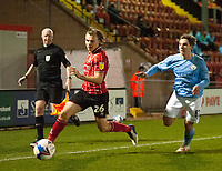 Lincoln City's Harry Anderson crosses under pressure from Manchester City U21's Adrian Berbnabe<br /> <br /> Photographer Andrew Vaughan/CameraSport<br /> <br /> EFL Papa John's Trophy - Northern Section - Group E - Lincoln City v Manchester City U21 - Tuesday 17th November 2020 - LNER Stadium - Lincoln<br />  <br /> World Copyright © 2020 CameraSport. All rights reserved. 43 Linden Ave. Countesthorpe. Leicester. England. LE8 5PG - Tel: +44 (0) 116 277 4147 - admin@camerasport.com - www.camerasport.com