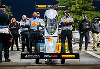 Oct 3, 2020; Madison, Illinois, USA; Crew members stand alongside the dragster of NHRA top fuel driver Tony Schumacher during qualifying for the Midwest Nationals at World Wide Technology Raceway. Mandatory Credit: Mark J. Rebilas-USA TODAY Sports