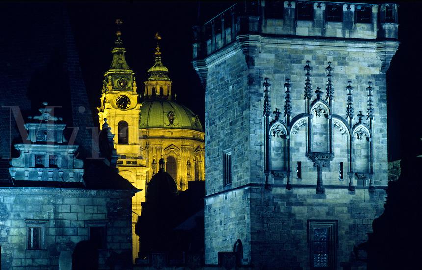 ST. NICHOLAS CHURCH is seen through the TOWER OF CHARLES BRIDGE in historic PRAGUE - CZECH REPUBLIC
