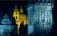 ST. NICHOLAS CHURCH is seen through the TOWER OF CHARLES BRIDGE in historic PRAGUE - CZECH REPUBLIC