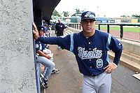 Corpus Christi Hooks outfielder Leo Heras (8) poses during a rain delay during a game against the NW Arkansas Naturals on May 26, 2014 at Arvest Ballpark in Springdale, Arkansas.  NW Arkansas defeated Corpus Christi 5-3.  (Mike Janes/Four Seam Images)