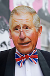 """Queen Elizabeth ii Diamond Jubilee fancy dress ball at the Chelsea Arts Club. """"A Night of a 1000 Queens"""". Prince Charles mask."""
