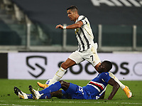 Calcio, Serie A: Juventus - Sampdoria, Turin, Allianz Stadium, September 20, 2020.<br /> Sampdoria's Omar Colley (Bottom) tackles Juventus' Cristiano Ronaldo during the Italian Serie A football match between Juventus and Sampdoria at the Allianz stadium in Turin, September 20,, 2020.<br /> UPDATE IMAGES PRESS/Isabella Bonotto