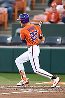Third baseman Patrick Cromwell (25) of the Clemson Tigers bats in a game against the William and Mary Tribe on February 16, 2018, at Doug Kingsmore Stadium in Clemson, South Carolina. Clemson won, 5-4 in 10 innings. (Tom Priddy/Four Seam Images)