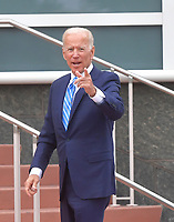 MIAMI, FLORIDA - JUNE 27: (EXCLUSIVE COVERAGE) Former Vice President Joe Biden looks like his is a great mood with a little spring in his step as he enters the Back door entrance prior to the debate on the second night of the first 2020 Democratic presidential debate. A field of 20 Democratic presidential candidates was split into two groups of 10 for the first debate of the 2020 election, taking place over two nights at Knight Concert Hall of the Adrienne Arsht Center for the Performing Arts of Miami-Dade County on June 27, 2019 in Miami, Florida<br /> <br /> <br /> People:  Joe Biden
