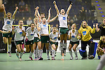 Berlin, Germany, January 31: Players of HTC Uhlenhorst Muehlheim celebrate after winning the 1. Bundesliga Damen Hallensaison 2014/15 semi-final hockey match between HTC Uhlenhorst Muehlheim (white/green) and Harvestehuder THC (black/yellow) on January 31, 2015 at the Final Four tournament at Max-Schmeling-Halle in Berlin, Germany. Final score 6-5 after penalties (3-1, 3-3, 3-3, 3-3). (Photo by Dirk Markgraf / www.265-images.com) *** Local caption ***