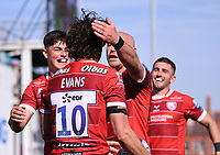 24th April 2021; Kingsholm Stadium, Gloucester, Gloucestershire, England; English Premiership Rugby, Gloucester versus Newcastle Falcons; Lloyd Evans celebrates with Willi Heinz and Louis Rees-Zammit of Gloucester on scoring Gloucester's fourth try