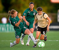 St. Louis Athletica midfielder Lori Chalupny (17) knocks the ball away from FC Gold Pride midfielder Tina DiMartino (5) during a WPS match at Korte Stadium, in St. Louis, MO, May 9 2009. St. Louis Athletica won the match 1-0.