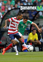 MEXICO CITY, MEXICO - AUGUST 15, 2012:  Edgar Castillo (15) of the USA MNT tackles Pablo Barrera (7) of  Mexico during an international friendly match at Azteca Stadium, in Mexico City, Mexico on August 15. USA won 1-0.