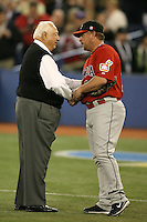 March 7, 2009:  Matt Stairs of Team Canada shakes hands with legendary manager Tommy Lasorda after throwing out the first pitch during the first round of the World Baseball Classic at the Rogers Centre in Toronto, Ontario, Canada.  Team USA defeated Canada 6-5 in both teams opening game of the tournament.  Photo by:  Mike Janes/Four Seam Images