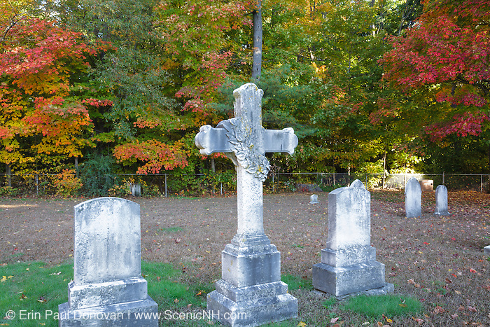 Old headstones at Saint Mary's Cemetery in Portsmouth, New Hampshire during the autumn months.