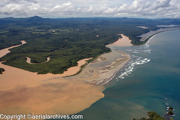 aerial photograph of sediment filled muddy river flowing into Pacific Ocean, Panama