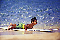 EDITORIAL ONLY.  Small boy practicing surfing.