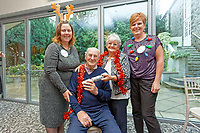 Pictured L-R: Lottery winners Karen Maddock 51, guests Graham Page, 82 with wife Bronny from Barry and lottery winner Julie Amphlett.  Wednesday 28 November 2018<br /> Re: National Lottery millionaires from south Wales and the south west of England have hosted a glitzy Rat Pack-inspired Christmas party for an older people's music group at The Bear Hotel in Cowbridge, Wales, UK.