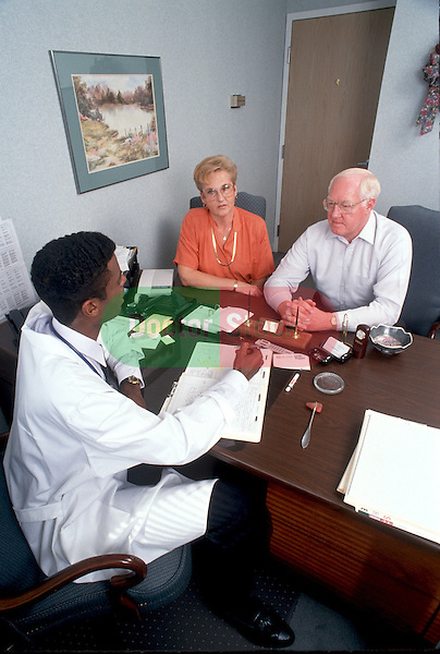Mature couple meets with physician