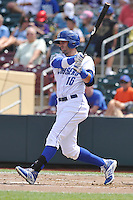 Designated hitter Paulo Orlando #16 of the Omaha Storm Chasers swings against the Las Vegas 51s at Werner Park on August 17, 2014 in Omaha, Nebraska. The Storm Chasers  won 4-0.   (Dennis Hubbard/Four Seam Images)
