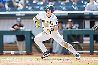 Michigan Wolverines first baseman Jimmy Kerr (15) lays down a bunt single during Game 11 of the NCAA College World Series against the Texas Tech Red Raiders on June 21, 2019 at TD Ameritrade Park in Omaha, Nebraska. Michigan defeated Texas Tech 15-3 and is headed to the CWS Finals. (Andrew Woolley/Four Seam Images)