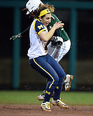 Michigan Wolverines Softball infielder Abby Ramirez (1) gets run into trying to field a ball during a game against the University of South Florida Bulls on February 8, 2014 at the USF Softball Stadium in Tampa, Florida.  Michigan defeated USF 3-2.  (Copyright Mike Janes Photography)