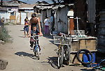 Children play on a street in Suto Orizari, Macedonia. The mostly Roma community, located just outside Skopje, is Europe's largest Roma settlement. .