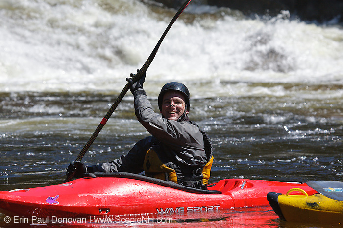 Kayaker at Lower Falls along the Swift River during the spring months in the White Mountains, New Hampshire USA