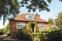 BNPS.co.uk (01202 558833)<br /> Pic: Mullucks/BNPS<br /> <br /> Before.<br /> <br /> A retired couple dubbed 'the accidental upsizers' have put their luxury home on the market for a whopping £750,000.<br /> <br /> Jean and Desmond Lawton bought a suburban bungalow three years ago as they looked to downsize from a large property.<br /> <br /> But they soon decided that they didn't like the dated decour of the humble home and transformed it beyond recognition.<br /> <br /> They knocked down every internal retaining wall bar one to create an open-plan space and built a single-storey extension to the rear.