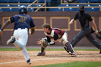 North Carolina Central Eagles catcher Chet Sikes (7) waits for a throw as Cameran Brantley (32) of the North Carolina A&T Aggies hustles towards home plate at Durham Athletic Park on April 10, 2021 in Durham, North Carolina. (Brian Westerholt/Four Seam Images)