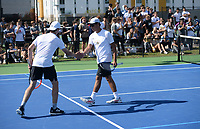 Bentonville's Santiago Aguirre (right) and doubles partner Boyce Read celebrate a point Tuesday, Oct. 12, 2021, during the 6A state tennis finals at Memorial Park in Bentonville. Visit nwaonline.com/211013Daily/ for today's photo gallery.<br /> (NWA Democrat-Gazette/Andy Shupe)