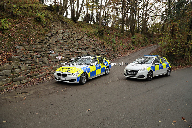 Pictured: Police at the entrance to the track leading to the house that burned in Llangammarch Wells, Powys, Wales, UK. Tuesday 31 October 2017<br />Re: Investigations continue into a house fire in which a father and several of his children have died.<br />Three children aged 13, 12 and 10 escaped the farmhouse in Llangammarch Wells, Powys, in the early hours of Monday and raised the alarm.<br />Police said they could not identify the deceased or confirm numbers.<br />One of those missing has been named locally as David Cuthbertson.