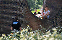 SURREY, ENGLAND. 25.05.2020<br /> .<br /> Police arrive to tell people to leave the Viaduct during the bank holiday Monday Covid-19 lockdown with government guidelines to social distance  at OUSE RIVER VALLEY VIADUCT, England at  on 25 May 2020. Photo by Alan Stanford.