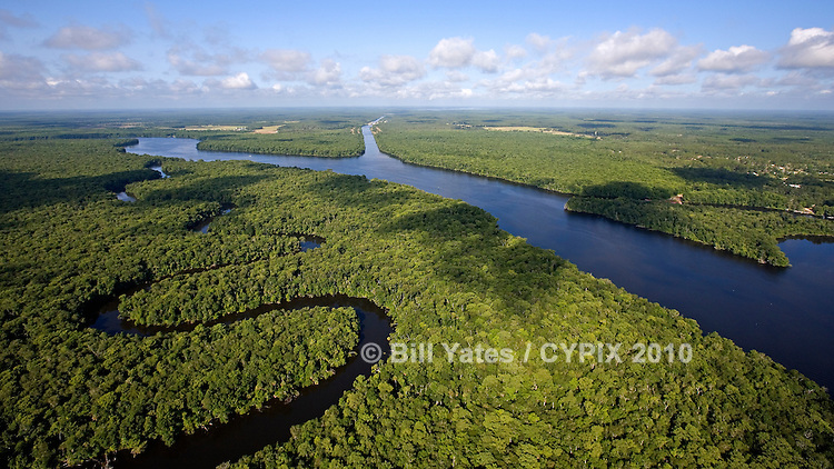 Above Trout Island, one of the Seven Sisters Islands located in the St. Johns River in Putnam County. The serpentine waterway is Trout Creek. This area is south of the Buffalo Bluff railroad trestle bridge in Satsuma, Florida. View to the southwest looking into the mouth of the Cross Florida Barge Canal. Rodman Dam and Lake Ocklawaha is on the horizon. Image was shot on 06.07.08 Aerial Photo (helicopter - 250 to 300 feet AGL)