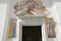 Switzerland. Canton of Ticino. Val di Blenio (Blenio valley). Aquila. Entrance door to a catholic church. Religious symbols and drawings. © 2006 Didier Ruef