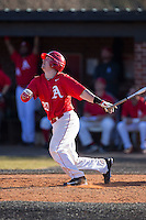Jacob Dietz (20) of the Belmont Abbey Crusaders follows through on his swing against the Shippensburg Raiders at Abbey Yard on February 8, 2015 in Belmont, North Carolina.  The Raiders defeated the Crusaders 14-0.  (Brian Westerholt/Four Seam Images)