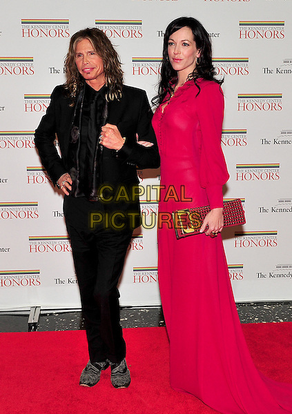 Steven Tyler and Erin Brady.The formal Artist's Dinner at the United States Department of State in Washington, D.C., USA..December 4th, 2010.full gold clutch bag length black suit red dress couple.CAP/ADM/RS.©Ron Sachs/CNP/AdMedia/Capital Pictures.