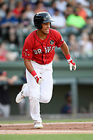 Third baseman Brandon Howlett (35) of the Greenville Drive runs out a batted ball in a game against the Rome Braves on Friday, June 28, 2019, at Fluor Field at the West End in Greenville, South Carolina. Rome won, 4-3. (Tom Priddy/Four Seam Images)