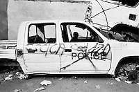 Child playing in destroyed police vehicle on the day of the elections in Port-Au-Prince.