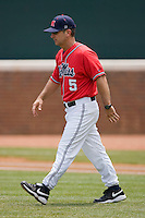 Ole Miss Rebels head coach Mike Bianco #5 walks out to the mound to talk to his pitcher during a game against the St. John's Red Storm at the Charlottesville Regional of the 2010 College World Series at Davenport Field on June 6, 2010, in Charlottesville, Virginia.  The Red Storm defeated the Rebels 20-16.  Photo by Brian Westerholt / Four Seam Images