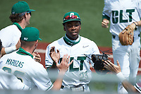 LuJames Groover III (23) of the Charlotte 49ers is congratulated by his teammates after making a play on defense during the game against the UTSA Roadrunners at Hayes Stadium on April 18, 2021 in Charlotte, North Carolina. (Brian Westerholt/Four Seam Images)