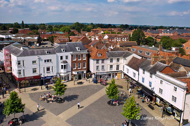 The Market Place at Abingdon-on-Thames, Oxfordshire looking north from the roof of the County Hall Museum. The County Hall, now a museum, is on the left and market stalls on the right of the road was built in 1678 by Christopher Kempster, who is believed to have worked with Wren on St Paul's Cathedral in London. Abingdon was situated in the county of Berkshire, but under local government re-organisation in 1974 it was transferred to Oxfordshire.