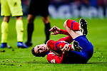 Lucas Hernandez of Atletico de Madrid lies injured after been challenged by Sergio Busquets of FC Barcelona during the La Liga 2018-19 match between Atletico Madrid and FC Barcelona at Wanda Metropolitano on November 24 2018 in Madrid, Spain. Photo by Diego Souto / Power Sport Images