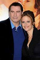 """12 July 2020 - Actress and wife of John Travolta Kelly Preston dead at age 57 from breast cancer.25 March 2010 - Hollywood, California - John Travolta and wife Kelly Preston. """"The Last Song"""" World Premiere held at Arclight Cinemas. Photo Credit: Byron Purvis/AdMedia"""